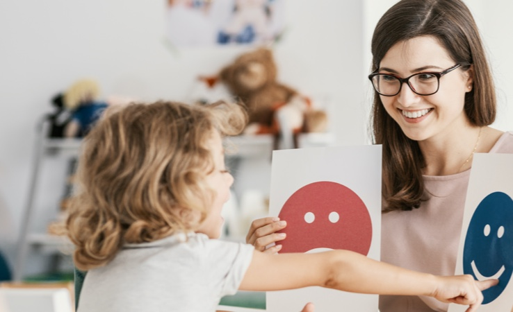 Kid Pointing at Smiley Picture